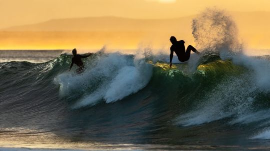 Pair of sunrise surfers - Louis Lotter
